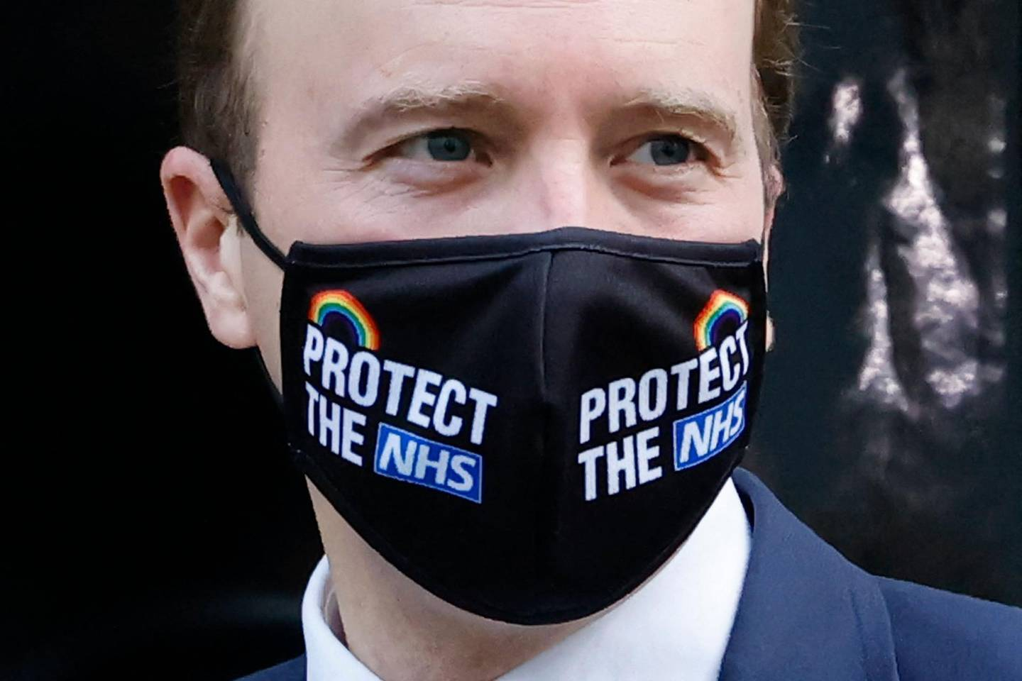 (FILES) In this file photo taken on December 16, 2020 Britain's Health Secretary Matt Hancock arrives at 10 Downing Street wearing a 'protect the NHS' mask because of the coronavirus pandemic in London. A British newspaper on June 25, 2021, reported that Britain's Health Secretary Matt Hancock has been having an affair with a close aide Gina Coladangelo, whom he appointed to his team in secret last year. / AFP / Tolga Akmen