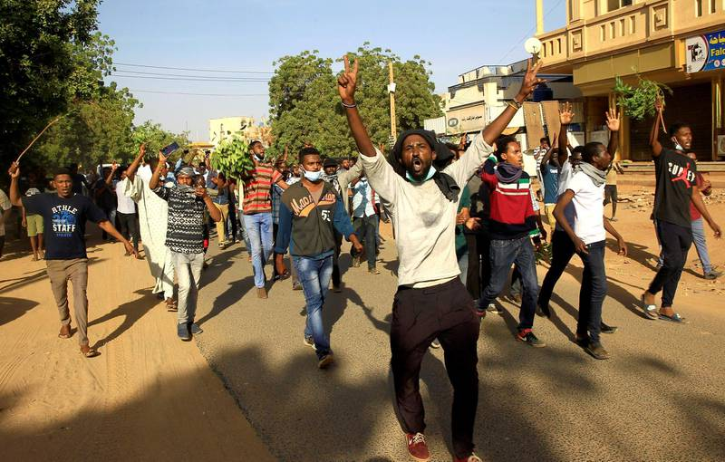 Sudanese demonstrators chant slogans as they march along the street during anti-government protests in Khartoum, Sudan December 25, 2018. REUTERS/Mohamed Nureldin Abdallah