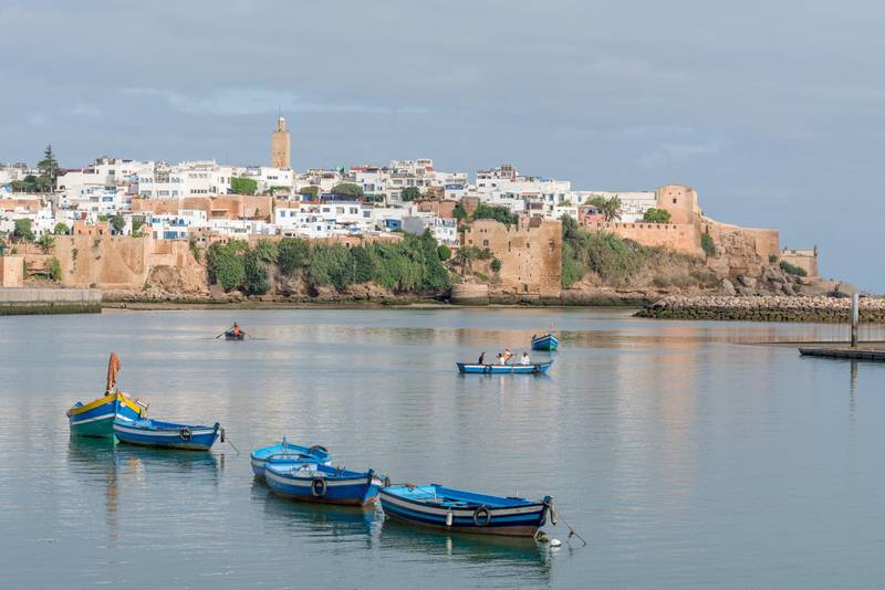Early morning view of Kasbah of the Udayas in Rabat, capital city of Morocco with fishing boats on river. Getty Images