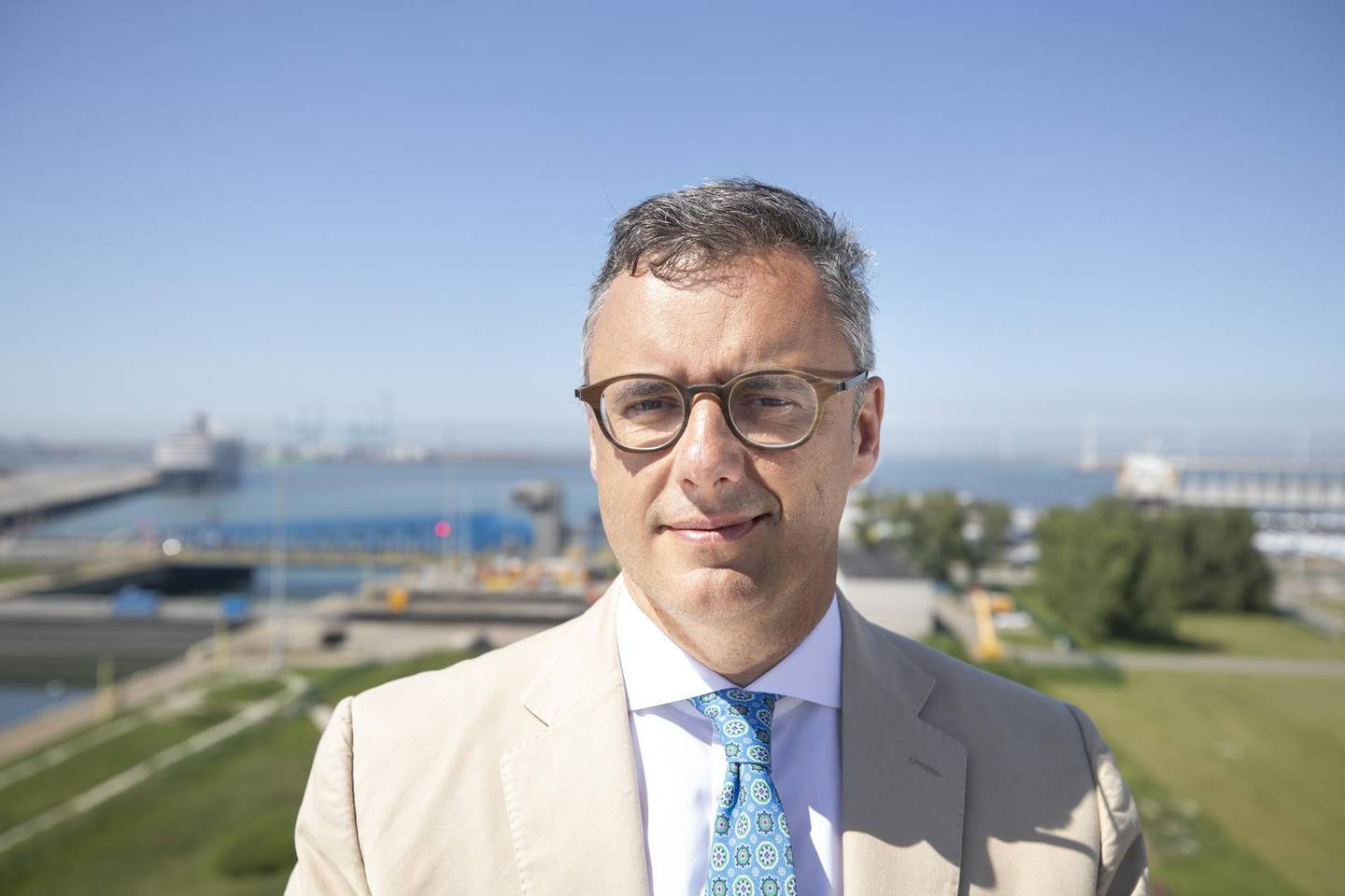 Joachim Coens, chief executive officer of the Port of Zeebrugge, poses for a photograph following an interview in Zeebrugge, Belgium, on Monday, May 7, 2018. With Brexit due in 10 months, Zeebrugge embodies the repeated warnings by the U.K.'s EU partners that its departure from the bloc is a lose-lose move by adding bureaucracy for businesses and costs for consumers. Photographer: Jasper Juinen/Bloomberg