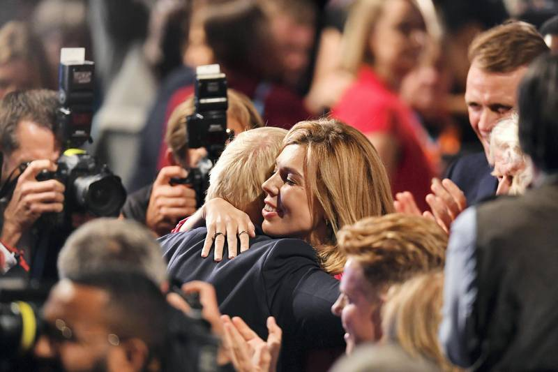 MANCHESTER, ENGLAND - OCTOBER 02: Prime Minister Boris Johnson embraces his girlfriend Carrie Symonds following his keynote speech on day four of the 2019 Conservative Party Conference at Manchester Central on October 2, 2019 in Manchester, England. The U.K. government prepares to formally submit its finalised Brexit plan to the EU today. The offer replaces the Northern Irish Backstop with border, customs and regulatory checks lasting until 2025. (Photo by Jeff J Mitchell/Getty Images)