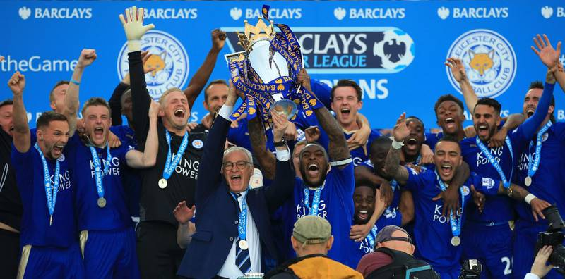File photo dated 07-05-2016 of Leicester City captain Wes Morgan and manager Claudio Ranieri lift the trophy as the team celebrate winning the Barclays Premier League, after the match at the King Power Stadium, Leicester. PA Photo. Issue date: Tuesday May 12, 2020. As Wes Morgan lifted the Premier League trophy, the impossible dream was realised. See PA story SOCCER Captains Morgan. Photo credit should read Nick Potts/PA Wire.