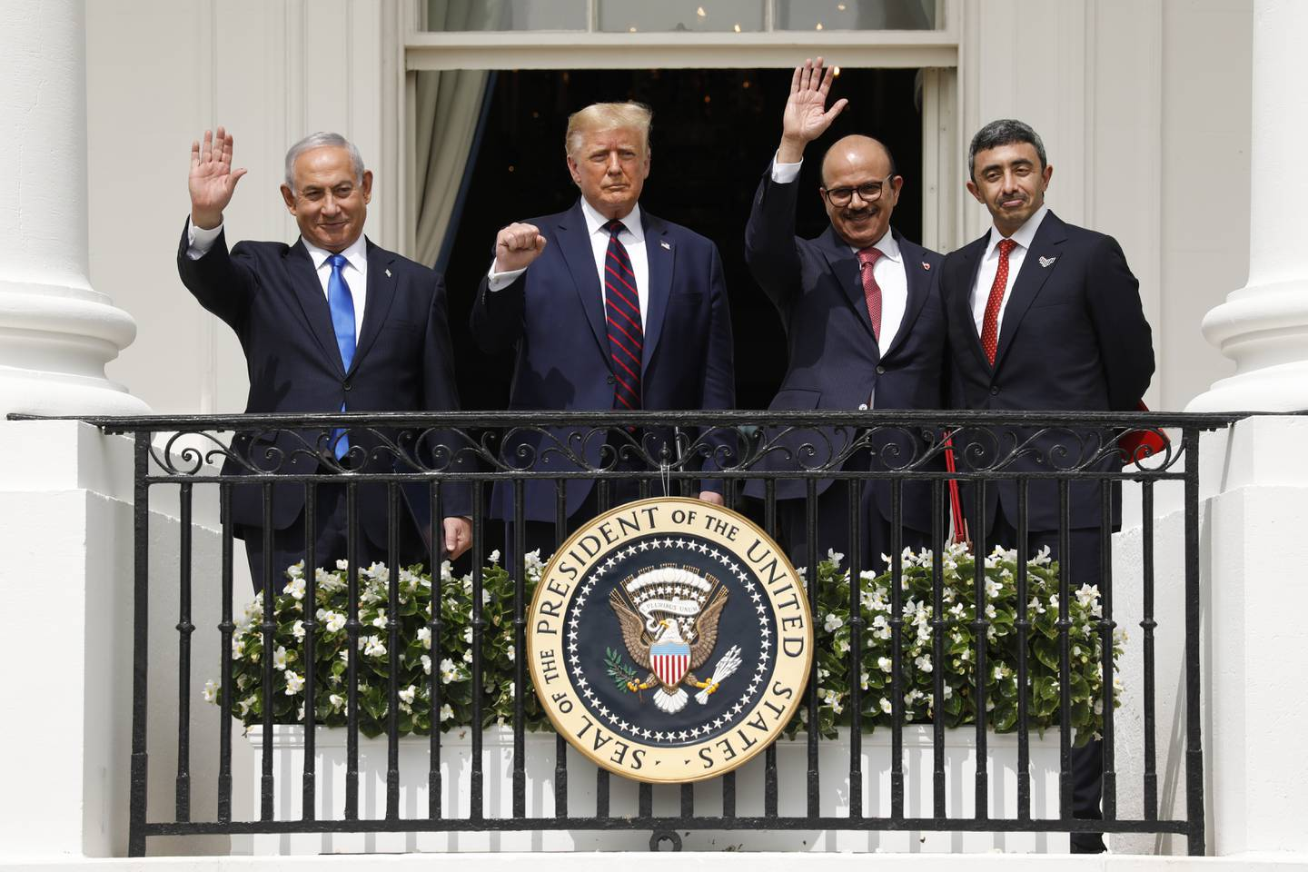 Benjamin Netanyahu, Israel's prime minister, from left, U.S. President Donald Trump, Abdullatif bin Rashid Al Zayani, Bahrain's foreign affairs minister, and Sheikh Abdullah bin Zayed bin Sultan Al Nahyan, United Arab Emirates' foreign affairs minister, stand during an Abraham Accords signing ceremony event on the South Lawn of the White House in Washington, D.C., U.S., on Tuesday, Sept. 15, 2020. The United Arab Emirates and Bahrain signed landmark agreements on Tuesday to move toward establishing normal relations with Israel, setting in motion a potentially historic shift in Mideast politics at a White House ceremony hosted by PresidentDonald Trump. Photographer: Yuri Gripas/Abaca/Bloomberg