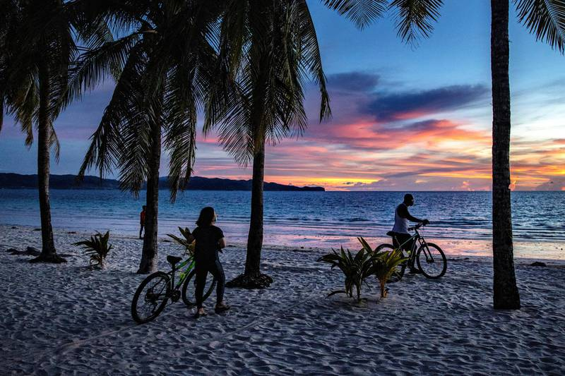 Boracay Island, PHILIPPINES - SEPTEMBER 30: Visitors flock to a beach on September 30, 2020 in Boracay Island, Philippines. The Philippines is reopening Boracay Island, a popular tourist destination known for its resorts and beaches, to more visitors starting October 1 in a bid to revive its pandemic-hit tourism sector. Tourism accounted for almost 13% of the Philippines economic output last year, according to the Department of Tourism. The reopening of Boracay comes as the nation tries to stimulate the economy even as coronavirus cases continue to rise. The country surpassed 312,000 cases of COVID-19, with at least 5,504 deaths. (Photo by Ezra Acayan/Getty Images)