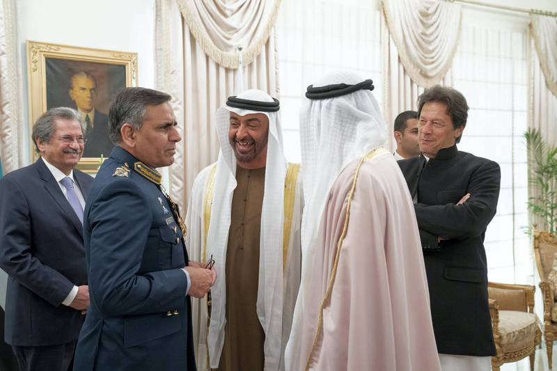 ISLAMABAD, PAKISTAN - January 06, 2019: HH Sheikh Mohamed bin Zayed Al Nahyan, Crown Prince of Abu Dhabi and Deputy Supreme Commander of the UAE Armed Forces (C), speaks with a guest during a reception at the Prime Minister's residence.  (  Mohammed Al Hammadi / Ministry of Presidential Affairs ) ---