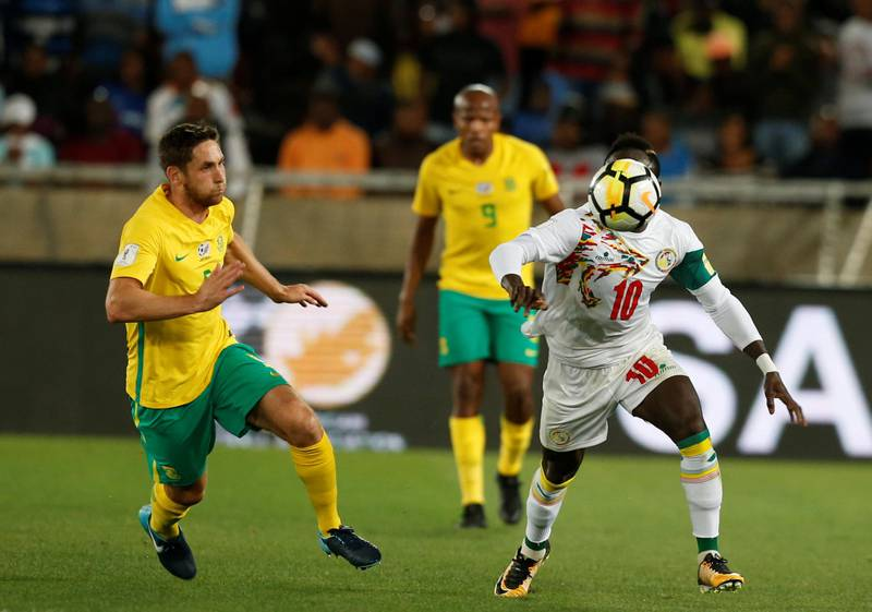 Soccer Football - 2018 World Cup Qualifiers - South Africa v Senegal - Peter Mokaba Stadium, Polokwane, South Africa - November 10, 2017   Senegal's Sadio Mane in action with South Africa's Dean Furman. REUTERS/Siphiwe Sibeko