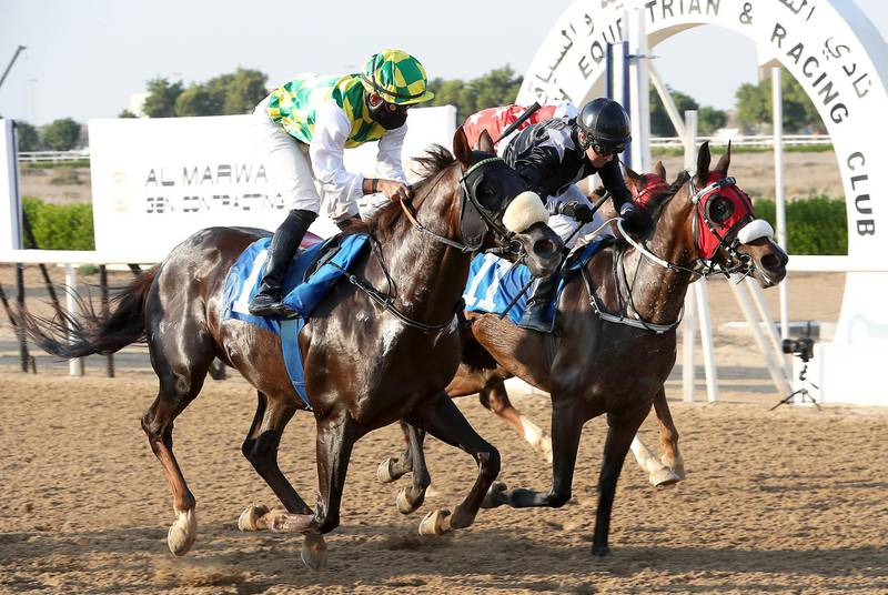 SHARJAH, UNITED ARAB EMIRATES , December 12 – 2020 :-  Fernando Jara (no 1 left side) guides Jawaal  (AE)  to win the 5th horse race HH Sheikh Mansoor bin Zayed Al Nahyan Cup 1200m Dirt at the Sharjah Longines Racecourse in Sharjah. ( Pawan Singh / The National ) For Sports/Online. Story by Amith
