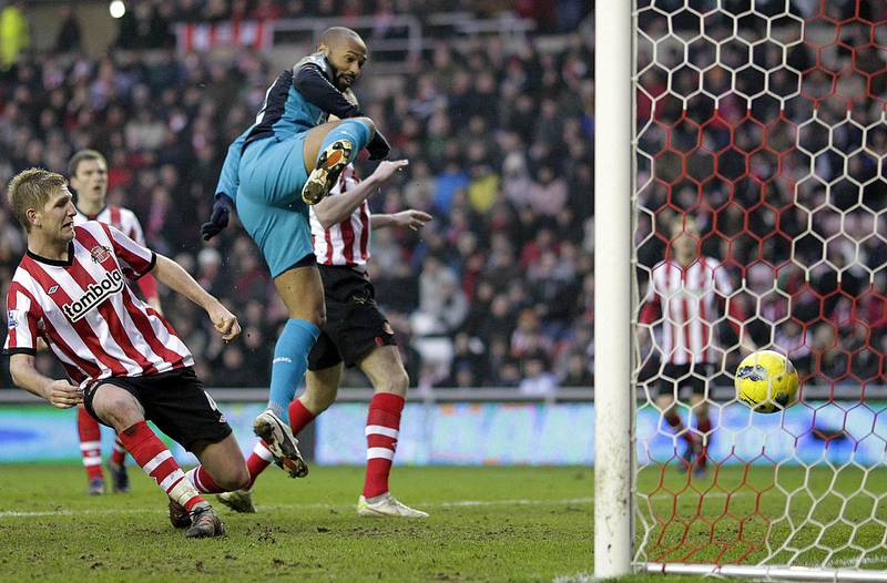 """Arsenal's French striker Thierry Henry (3rd L) scores their 2nd goal during the English Premier League football match between Sunderland and Arsenal at The Stadium of Light in Sunderland, north-east England on February 11, 2012. AFP PHOTO/GRAHAM STUART  RESTRICTED TO EDITORIAL USE. No use with unauthorized audio, video, data, fixture lists, club/league logos or """"live"""" services. Online in-match use limited to 45 images, no video emulation. No use in betting, games or single club/league/player publications. (Photo by GRAHAM STUART / AFP)"""