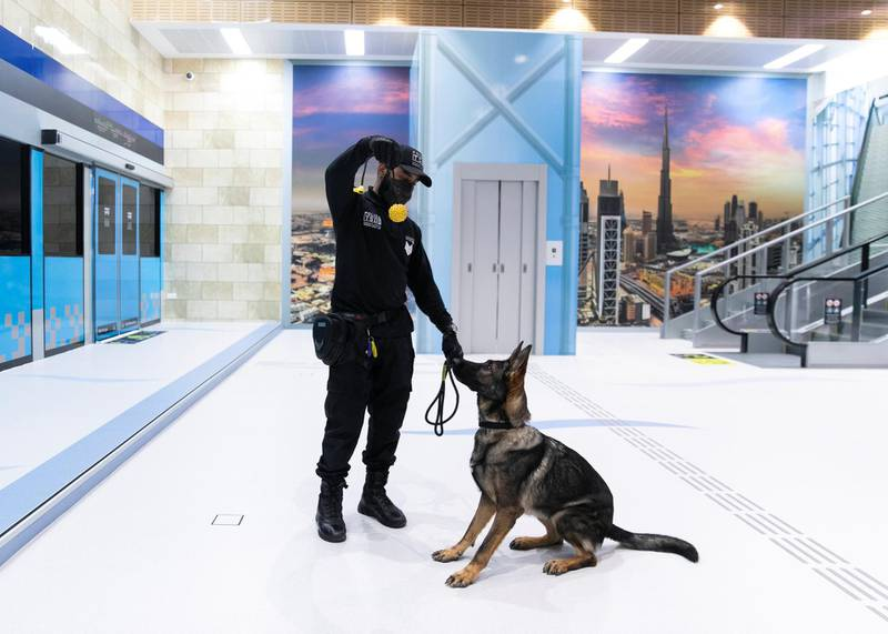 DUBAI, UNITED ARAB EMIRATES. 15 NOVEMBER 2020. Transport Security Department officer with Ariel, a police dog, at Hamdan Smart Station for Simulation and Training. The training facility of the Transport Security Department in Dubai aims to enhance security efforts and increase the readiness of security and law enforcement personnel. Equipped with the latest tools, the station utilises virtual reality and simulation technologies to provide comprehensive scenario-based emergency training.(Photo: Reem Mohammed/The National)Reporter:Section: