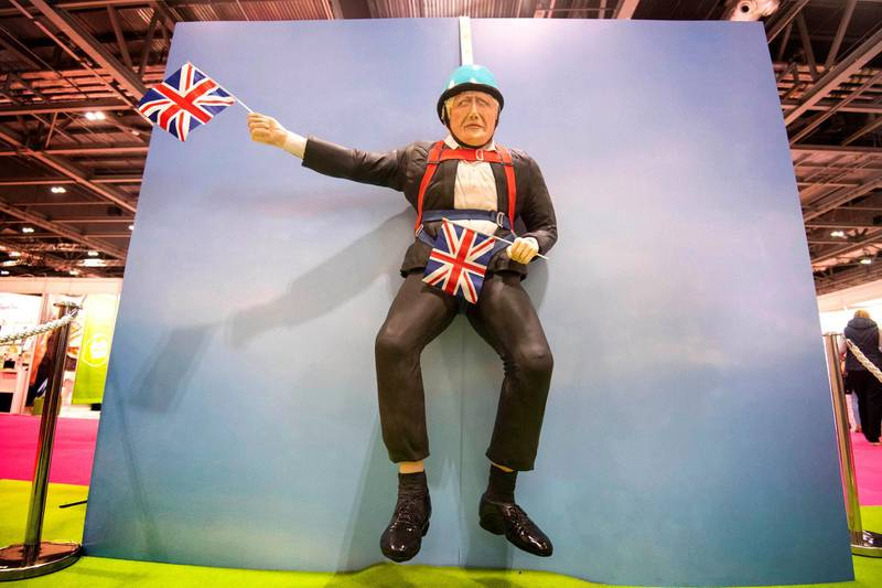 A life-sized cake depicting British Prime Minister Boris Johnson is seen at the Cake and Bake Show at ExCeL in London, Friday, Oct 4, 2019. (Victoria Jones/PA via AP)