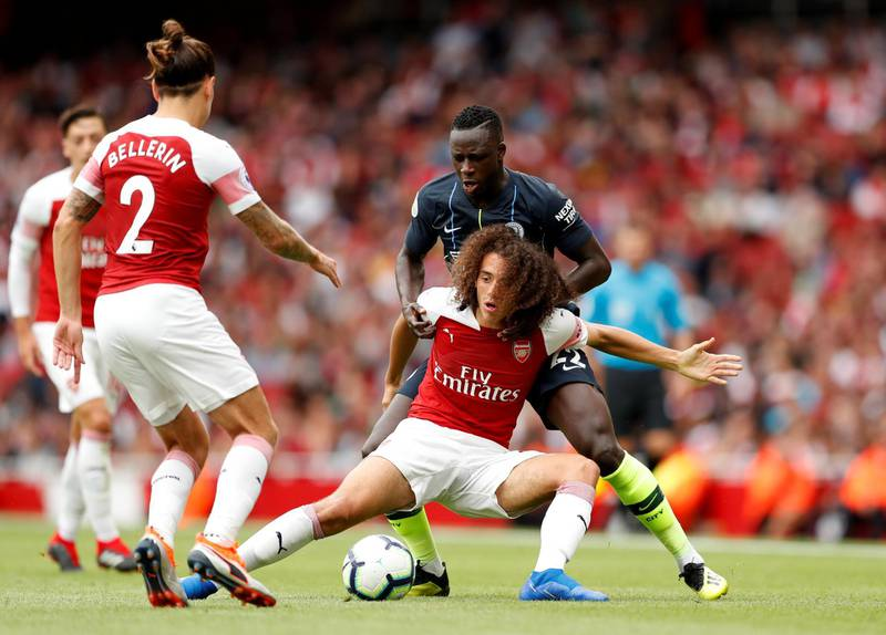 """Soccer Football - Premier League - Arsenal v Manchester City - Emirates Stadium, London, Britain - August 12, 2018   Manchester City's Benjamin Mendy in action with Arsenal's Matteo Guendouzi   Action Images via Reuters/John Sibley    EDITORIAL USE ONLY. No use with unauthorized audio, video, data, fixture lists, club/league logos or """"live"""" services. Online in-match use limited to 75 images, no video emulation. No use in betting, games or single club/league/player publications.  Please contact your account representative for further details."""