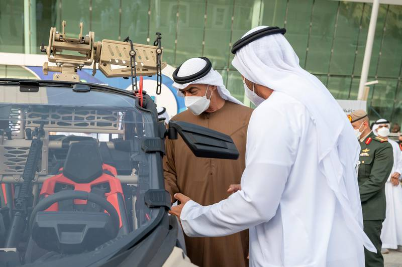 ABU DHABI, UNITED ARAB EMIRATES - February 23, 2021: HH Sheikh Mohamed bin Zayed Al Nahyan, Crown Prince of Abu Dhabi and Deputy Supreme Commander of the UAE Armed Forces (2nd R), tours the International Defence Exhibition and Conference (IDEX), at ADNEC.  ( Mohamed Al Hammadi / Ministry of Presidential Affairs ) ---