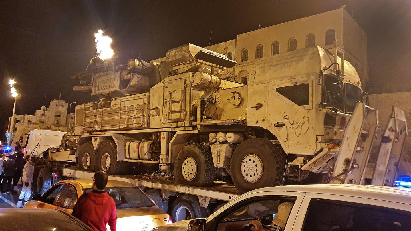 Forces loyal to Libya's UN-recognised Government of National Accord (GNA) parade a Pantsir air defense system truck in the capital Tripoli on May 20, 2020, after its capture at al-Watiya airbase (Okba Ibn Nafa airbase) from forces loyal to Libya's eastern-based strongman Khalifa Haftar. Libya's UN-recognised government scored another battlefield victory on May 18 against strongman Khalifa Haftar, capturing the key rear base used by his fighters in a conflict now in its second year. Haftar, who controls swathes of eastern Libya, launched an offensive in April last year against the capital Tripoli, seat of the UN-recognised Government of National Accord (GNA). / AFP / Mahmud TURKIA