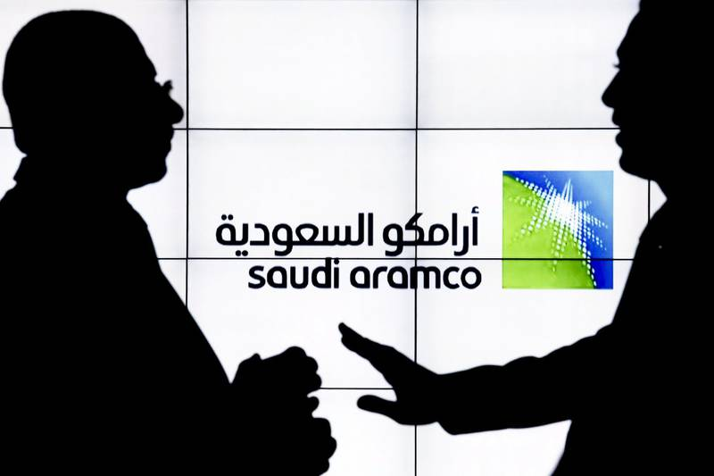 A Saudi Arabian Oil Co. (Aramco) logo sits on an electronic display at the company's corporate pavilion during the 22nd World Petroleum Congress in Istanbul, Turkey, on Wednesday, July 12, 2017. Oilfell from the lowest closing price in two weeks as talk of Libya and Nigeria being requested to cap their production failed to dispel doubts about the effectiveness of OPEC's cut. Photographer: Kostas Tsironis/Bloomberg