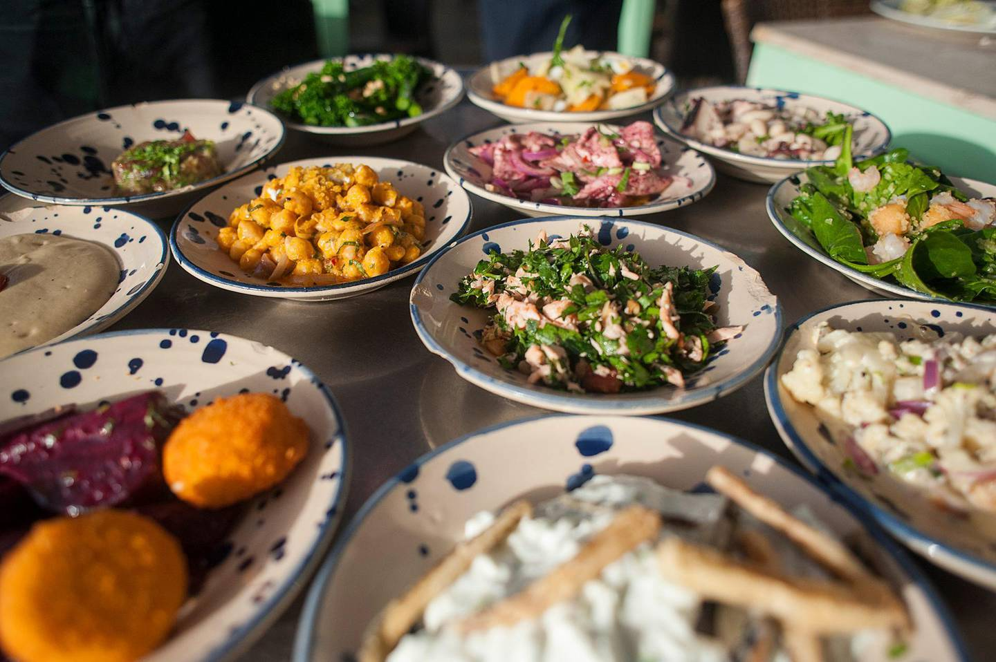 Dishes of cold meze are served at a restaurant in Israel. Photographer: Geraldine Hope Ghelli/Bloomberg