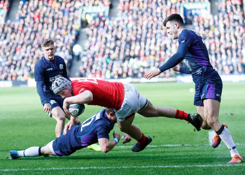 epa07424771 Jonathan Davies of Wales scores the second try during the Guinness Six Nations Rugby match Scotland v Wales in Edinburgh, Britain, 09 March 2019.  EPA/Robert Perry
