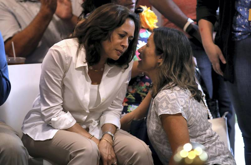 """DES MOINES, IOWA - AUGUST 10: Democratic presidential hopeful U.S. Sen. Kamala Harris (L) (D-CA) talks with her aide Julie Chavez Rodriguez (R) during the Asian and Latino Coalition event at Jasper Winery on August 10, 2019 in Des Moines, Iowa. Kamala Harris is on a five day river-to-river bus tour across Iowa promoting her """"3AM Agenda"""" to Iowans.   Justin Sullivan/Getty Images/AFP"""
