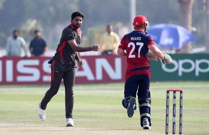 ABU DHABI , UNITED ARAB EMIRATES , October 22  – 2019 :- Junaid Siddique of UAE ( left ) celebrating after taking the wicket of Ben Ward during the World Cup T20 Qualifiers between UAE vs Jersey held at Tolerance Oval cricket ground in Abu Dhabi.  ( Pawan Singh / The National )  For Sports. Story by Paul