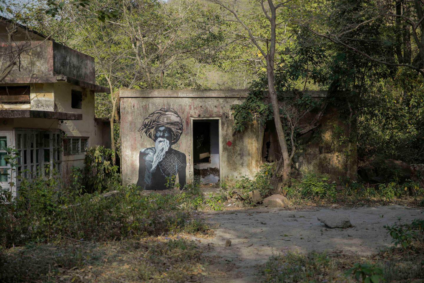 *** EXCLUSIVE ***RISHIKESH, INDIA - MARCH 21, 2016: Painting of Maharishi Mahesh Yogi, on March 21, 2016 in Rishikesh, Uttarakhand, India.AN abandoned Hindu monastery that was once home to the Beatles has become a place of pilgrimage for music fans and yogis seeking enlightenment. The ashram in Rishikesh, India, is located in the foothills of the Himalayas, an area known as the Yoga Capital of the World. Seen as a holy city by Hindus, Rishikesh has been a place of worship for centuries and gets visitors from all around the world coming to see the numerous temples and monasteries. During her time travelling through the holy sites, British photographer Kashfi Halford, 39, visited an ashram that once belonged to Maharishi Mahesh Yogi, a spiritual leader to both the Beatles and The Beach Boys.PHOTOGRAPH BY Kashfi Halford / Bacroft Images / Getty ImagesLondon-T:+44 207 033 1031 E:hello@barcroftmedia.com -New York-T:+1 212 796 2458 E:hello@barcroftusa.com -New Delhi-T:+91 11 4053 2429 E:hello@barcroftindia.com www.barcroftmedia.com (Photo credit should read Kashfi Halford / Bacroft Images / Barcroft Media via Getty Images)