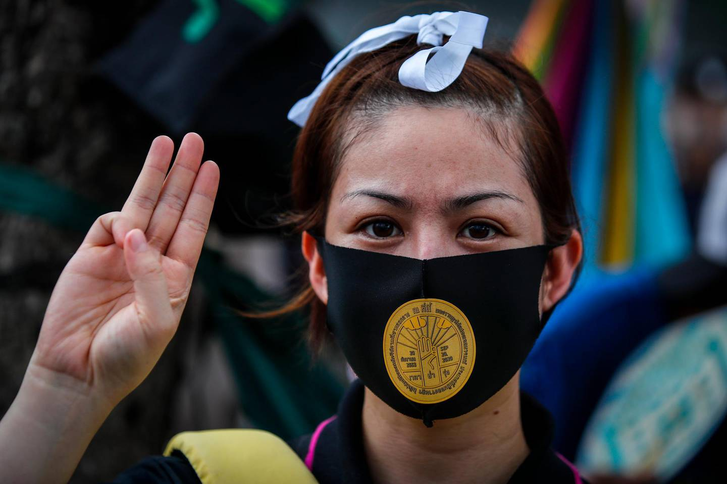 epa08693631 A Thai pro-democracy activist with a sticker of the memorial plaque of the 1932 Siamese Revolution on her mask, attends an anti-government protest outside the parliament in Bangkok, Thailand, 24 September 2020. Hundreds of anti-government protesters gathered outside the parliament to support the amendment of the constitution as the parliament of Thailand holds special sessions from 23 to 24 September 2020 to deliberate the charter amendment proposals and the establishment of a charter drafting group.  EPA/DIEGO AZUBEL
