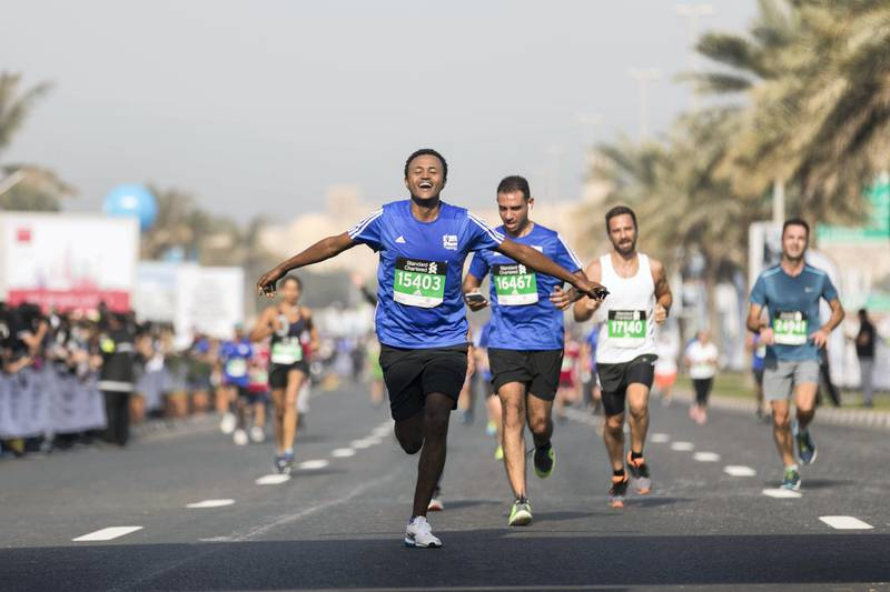 DUBAI, UNITED ARAB EMIRATES - Jan 26, 2018. Runners arriving at the finish line at the Standard Chartered Dubai Marathon. (Photo by Reem Mohammed/The National)Reporter: AmithSection: NA + SP