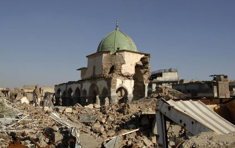 A view of the destroyed al-Nuri mosque in the old city of Mosul is seen on April 23, 2018. The United Arab Emirates and Iraq launched a joint effort to reconstruct Mosul's Great Mosque of al-Nuri and its iconic leaning minaret, ravaged last year during battles to retake the city from jihadists. During the ceremony at Baghdad's National Museum, UAE Culture Minister Noura al-Kaabi said her country would put forward $50.4 million (41.2 million euros) for the task.   / AFP PHOTO / Zaid al-Obeidi