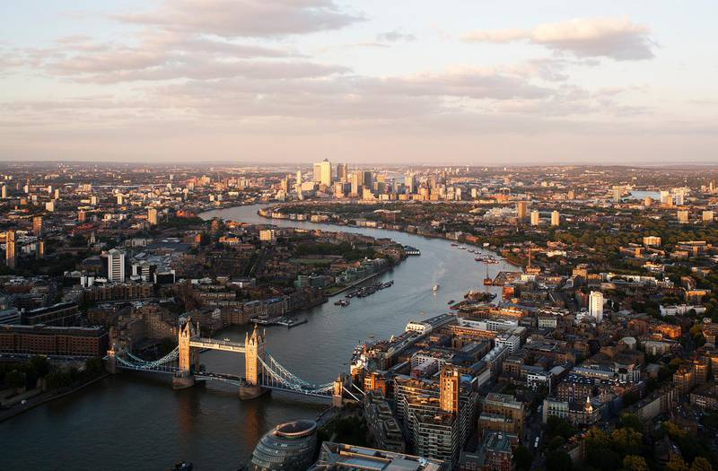 UK,London,elevated view over the City of London along the River Thames with the City and Tower Bridge at sunset