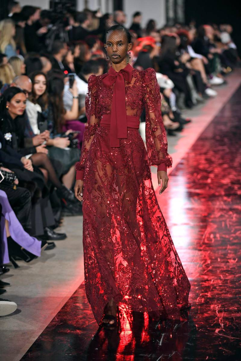 epa08259612 A model presents a creation by Lebanese designer Elie Saab from the Fall-Winter 2020/21 women's collection for Elie Saab fashion house during the Paris Fashion Week, in Paris, France, 29 February 2020. The Fall-Winter 2020/21 women's collection runs from 24 February to 03 March 2020.  EPA/JULIEN DE ROSA