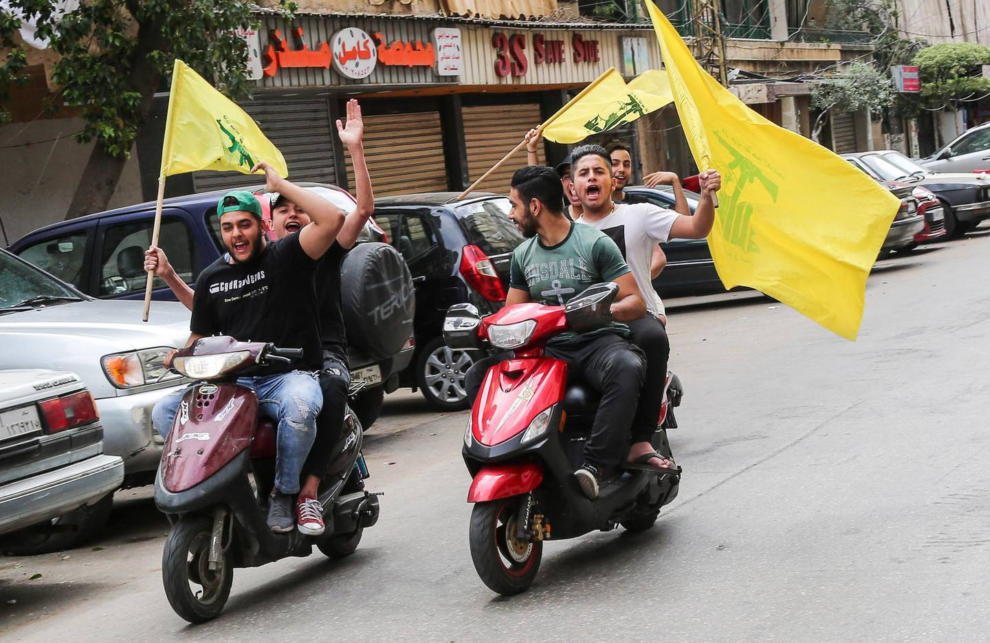 epa06715567 Supporter of Hezbollah carry their party flags and ride motorcycles at the southern suburb of Beirut, Lebanon, 06 May 2018. There are 976 candidates, including 111 women, competing for 128 seats in parliament divided equally between the Muslim and Christian sects,  during the general parliamentary elections after nine years of forced extension, through a new electoral law that adopts the percentage.  EPA/NABIL MOUNZER