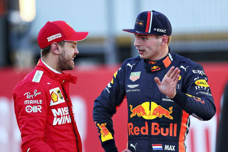 AUSTIN, TEXAS - NOVEMBER 02: Second place qualifier Sebastian Vettel of Germany and Ferrari talks with third place qualifier Max Verstappen of Netherlands and Red Bull Racing in parc ferme during qualifying for the F1 Grand Prix of USA at Circuit of The Americas on November 02, 2019 in Austin, Texas.   Dan Istitene/Getty Images/AFP