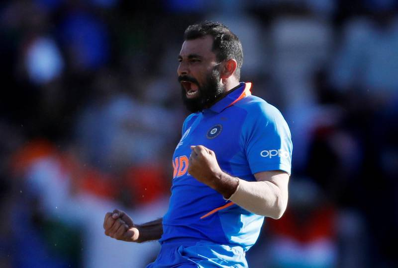 Cricket - ICC Cricket World Cup - India v Afghanistan - The Ageas Bowl, Southampton, Britain - June 22, 2019   India's Mohammed Shami celebrates taking the wicket of Afghanistan's Mujeeb Ur Rahman to complete a hat trick and win the match     Action Images via Reuters/Paul Childs