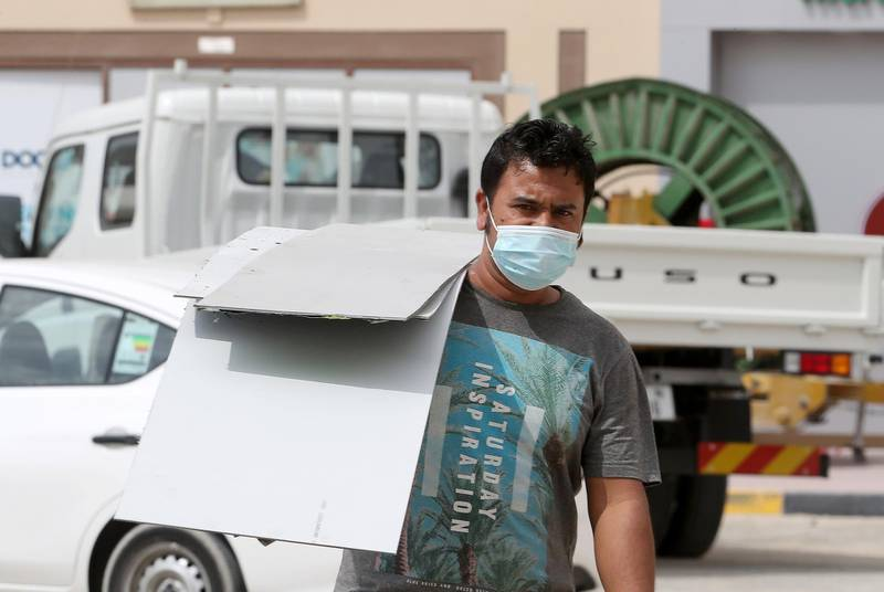 DUBAI, UNITED ARAB EMIRATES , Feb 25– 2020 :- People wearing protective face mask in Al Jadaf area in Dubai. UAE government told residents to wear face mask all the times outside the home whether they are showing symptoms of Covid-19 or not.  (Pawan Singh / The National) For News/Online
