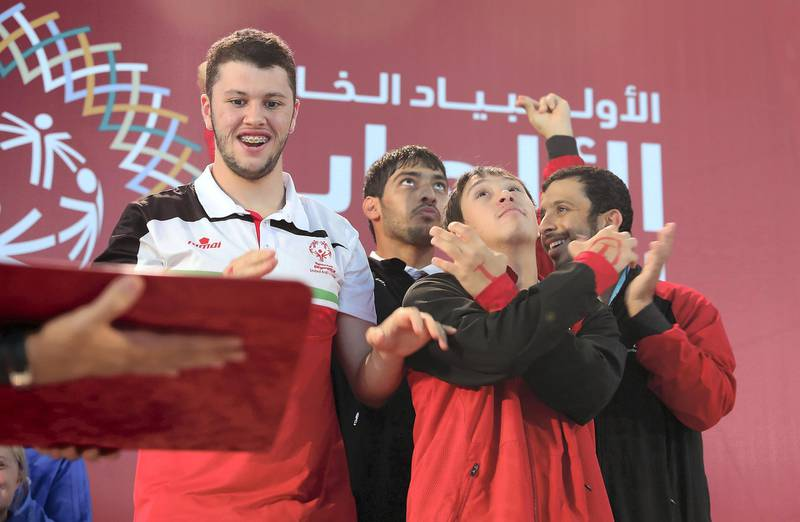 DUBAI , UNITED ARAB EMIRATES , March 20 – 2019 :- Left to Right - Khalid Albarguthi  , Abdullah Al Tajer , Omer Alshami and Awadh Alketbi during the victory ceremony of the 4x50m freestyle relay at the Special Olympic games held at Hamdan Sports Complex in Dubai. UAE won the bronze.  ( Pawan Singh / The National ) For News/Instagram/Online/Big Picture . Story by Ramola