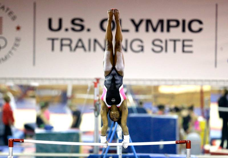 FILE - In this Sept. 12, 2015, file photo, U.S. gymnast Simone Biles trains at the Karolyi Ranch in New Waverly, Texas. Biles has met the new president of USA Gymnastics but hasn't heard from the U.S. Olympic Committee regarding the Larry Nassar sexual abuse scandal. The four-time gold medalist at the Rio Games is training for the 2020 Tokyo Olympics.  (AP Photo/David J. Phillip, File)
