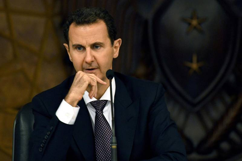 """This handout picture released by the official Syrian Arab News Agency (SANA) shows Syria's President Bashar al-Assad as he chairs the central committee of the ruling Baath party in Damascus on October 7, 2018. (Photo by - / SANA / AFP) / == RESTRICTED TO EDITORIAL USE - MANDATORY CREDIT """"AFP PHOTO / HO / SANA"""" - NO MARKETING NO ADVERTISING CAMPAIGNS - DISTRIBUTED AS A SERVICE TO CLIENTS =="""