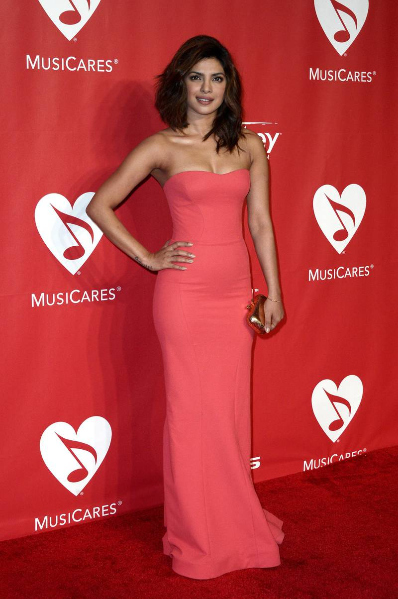 epa04606972 Indian actress/singer Priyanka Chopra arrives for the 2015 MusiCares Person of the Year gala in Los Angeles, California, USA 06 February 2015. The MusiCares Foundation honored singer Bob Dylan for his extraordinary creative accomplishments.  EPA/PAUL BUCK