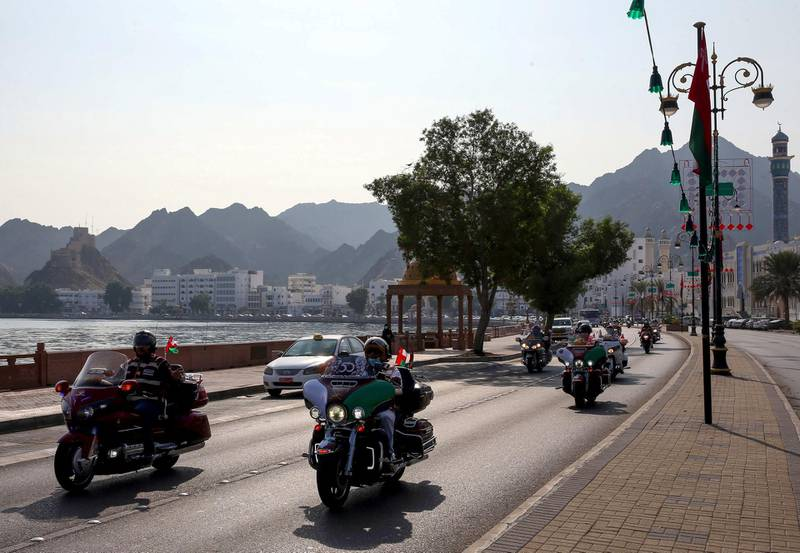 Bikers drive down a street in the Omani capital Muscat, on November 14, 2020, as part of the 50th National Day celebrations. (Photo by MOHAMMED MAHJOUB / AFP)