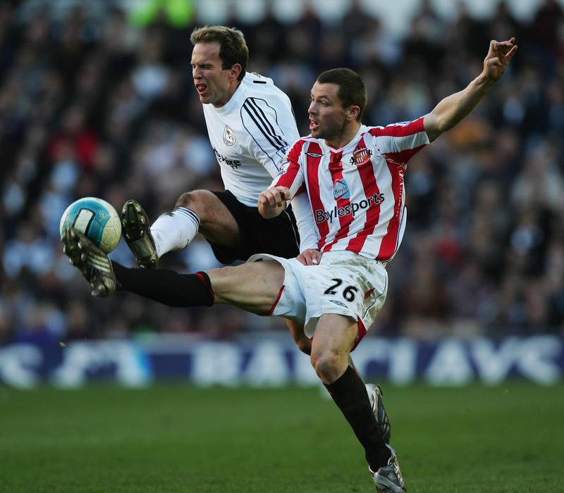 DERBY, UNITED KINGDOM - MARCH 01:  Phil Bardsley of Sunderland and Eddie Lewis of Derby County challenge for the ball during the Barclays Premier League match between Derby and Sunderland at Pride Park on March 01, 2008 in Derby, England.  (Photo by Matthew Lewis/Getty Images)