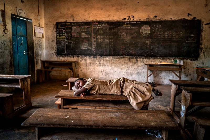 Aragon Renuncio Antonio - Sweet Dreams (School near Burkina Faso border)A girl sleeps on a desk inside her schoolroom. Extreme rains have tripled in the Sahel in the last 35 years due to global warming. Climate change has caused 70 episodes of torrential rains in the last decade although the region suffers severe episodes of drought.