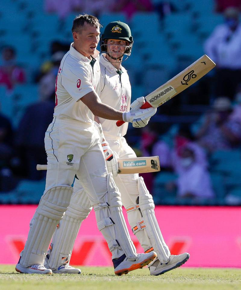 Australia's not out batsmen Marnus Labuschagne, left, and Steve Smith walk from the field at the close of play on day three of the third cricket test between India and Australia at the Sydney Cricket Ground, Sydney, Australia, Saturday, Jan. 9, 2021. (AP Photo/Rick Rycroft)