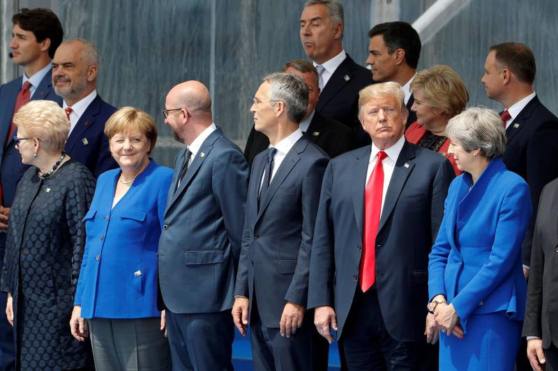 (LtoR) Lituania's President Dalia Grybauskaite, German Chancellor Angela Merkel, Belgium's Prime Minister Charles Michel, NATO Secretary General Jens Stoltenberg, US President Donald Trump and Britain's Prime Minister Theresa May attend the opening ceremony of the NATO (North Atlantic Treaty Organization) summit, at the NATO headquarters in Brussels, on July 11, 2018.  / AFP / GEOFFROY VAN DER HASSELT