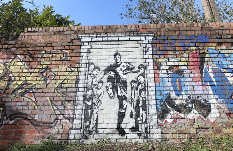 MANCHESTER, ENGLAND - MARCH 26: A mural of Manchester United player Marcus Rashford kicking down the door to No10 is seen by a canal near Old Trafford, the home of Manchester United FC, on March 26, 2021 in Manchester, England. (Photo by James Gill - Danehouse/Getty Images)