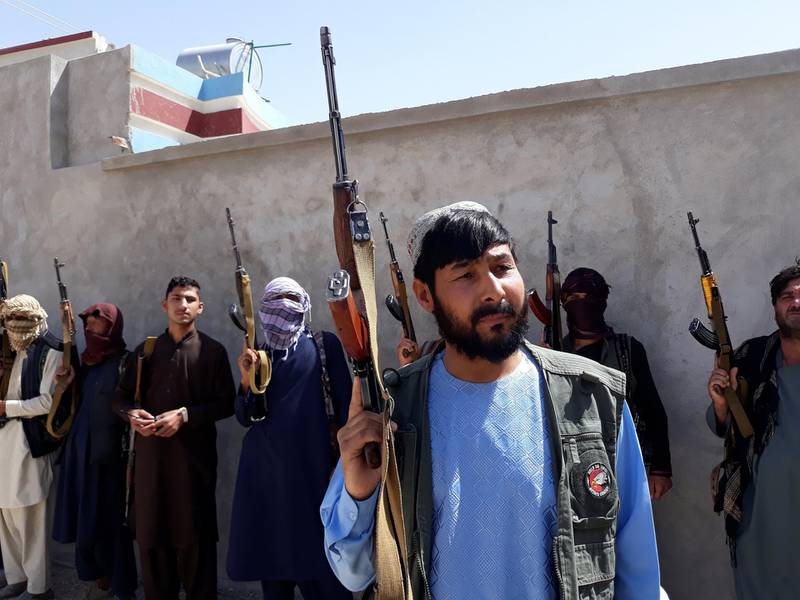 Thirty-year-old Qadir Shah, a local businessman, picked up arms last week to defend his city of Pul-e-Khumri against Taliban offensives. Today, he is already a commander of a small force of similar civilian fighters armed and supported by local leaders. Ajman Omari / The National