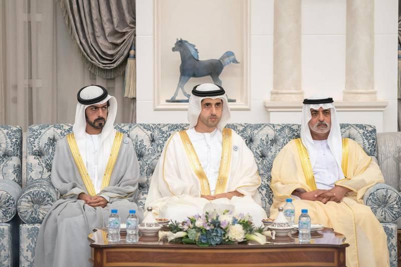 ABU DHABI, UNITED ARAB EMIRATES - August 21, 2018: (L-R) HH Sheikh Khalifa bin Tahnoon bin Mohamed Al Nahyan, Director of the Martyrs' Families' Affairs Office of the Abu Dhabi Crown Prince Court, HH Sheikh Saif bin Rashid Al Mualla and HH Sheikh Nahyan bin Mubarak Al Nahyan, UAE Minister of State for Tolerance, attend an Eid Al Adha reception at Mushrif Palace.   (Rashed Al Mansoori / Crown Prince Court - Abu Dhabi ) ---
