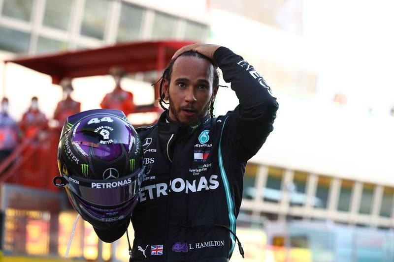 epa08666806 British Formula One driver Lewis Hamilton of Mercedes-AMG Petronas reacts after winning the Formula One Grand Prix of Tuscany at the race track in Mugello, Italy 13 September 2020.  EPA/Bryn Lennon / Pool