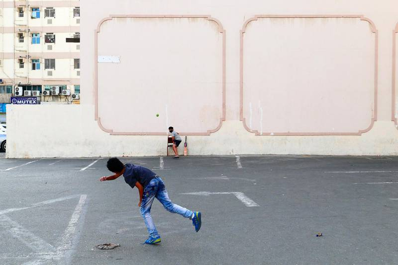 Kids playing cricket in the parking area in Bur Dubai in Dubai on April 5,2021. Pawan Singh / The National