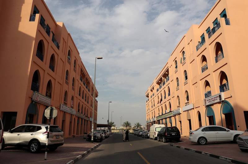 DUBAI, UNITED ARAB EMIRATES , April 18– 2020 :- View of the quiet street in International City in Dubai. Only two entrance are open for vehicles coming from Al Awir road before the Dragon Mart 1 and Manama Street to International City in Dubai.  Dubai is conducting 24 hours sterilisation programme across all areas and communities in the Emirate and told residents to stay at home. UAE government told residents to wear face mask and gloves all the times outside the home whether they are showing symptoms of Covid-19 or not.  (Pawan Singh / The National) For News/Online