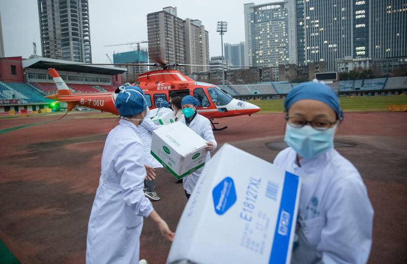epa08184452 Medical staff of Concorde hospital transfer medical supplies from a helicopter in Wuhan, Hubei Province, China, 01 February 2020. Hospitals in Wuhan and other parts of China are facing a shortage of protective masks, clothing and medical supplies as the novel coronavirus outbreak claimed so far 259 lives and infected close to 12,000 people worldwide.  EPA/YFC CHINA OUT