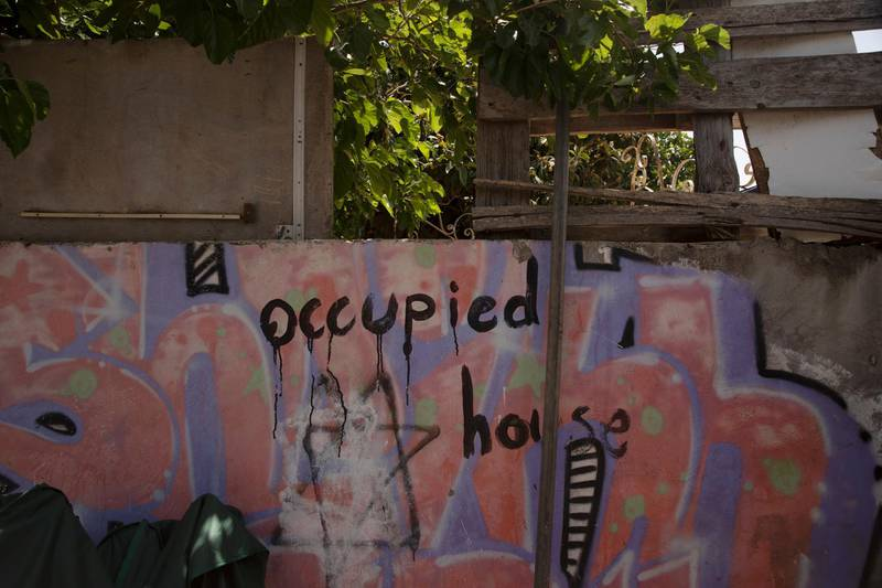 Graffitti marks the outer wall of the al-Kurd family property in the Sheikh Jarrah neighborhood of east Jerusalem, one of several Palestinian families under threat of forced eviction, Tuesday, May 11, 2021. Part of their property is already occupied by Jewish settlers. (AP Photo/Maya Alleruzzo)