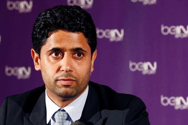 FILE PHOTO: Nasser Al-Khelaifi (L), Paris St Germain's club owner and owner of Qatari TV channel Al Jazeera Sport, President of beIN Sport French TV channel, attends a news conference in Paris May 24, 2012. Picture taken May 24, 2012.     REUTERS/Jacky Naegelen/File Photo